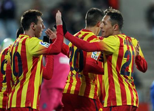 Messi and Adriano celebrating Barça's first goal against Getafe (by FC Barcelona)