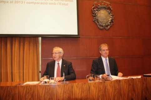 Miquel Valls (left) presenting the report (by J. Molina)