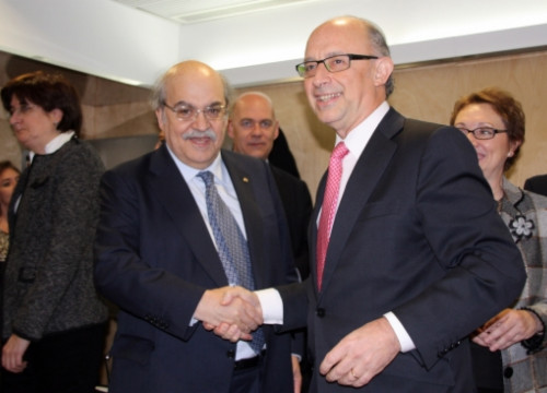 The Catalan Finance Minister (left) and the Spanish Finance Minister (right) (by R. Pi de Cabanyes)