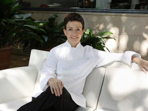 Carme Ruscalleda sitting at her restaurant's back yard (by C. Ruscalleda)