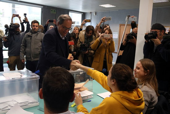 Was the Catalan president followed by Spanish police officers on election day?