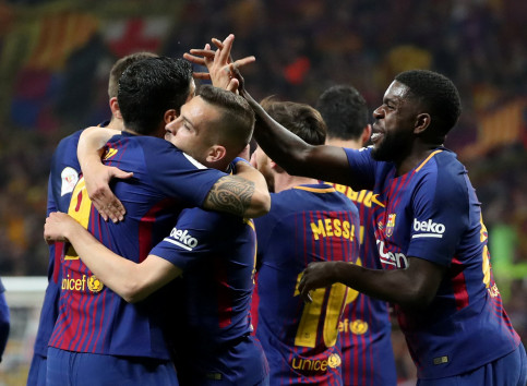 Barça players celebrating after Suarez scored first goal against Sevilla at the Copa del Rey in Madrid (REUTERS)