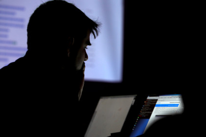 A man takes part in a hacking contest during the Def Con hacker convention in Las Vegas (REUTERS/Steve Marcus)