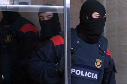 A member of the Catalan police, called Mossos d'Esquadra, in an operation