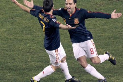 FC Barcelona players, Xavi and Villa, celebrate a goal during the South-Africa World Cup