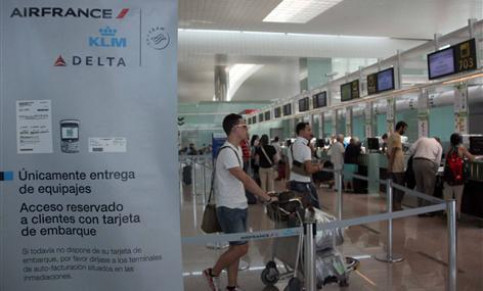 Passengers checking in at Barcelona's airport