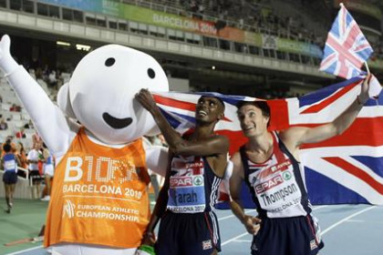 Great Britain's Farah and Thompson celebrate gold and silver medal in the 10000 metres men final at the European Athletics Champ