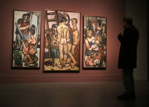 A museum-goer looks at 'The Argonauts,' the last piece created by Max Beckmann, at an exhibit in the CaixaForum on February 20 2019 (by Pau Cortina)