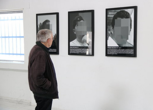 A museum-goer looks at photos at the ARCO exhibit in Madrid on February 25 2019 (by Andrea Zamorano)