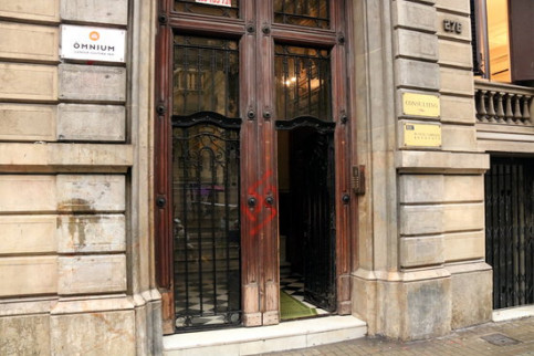 A painted swastika is visible on the door of the Òmnium HQ in Barcelona on November 26 2018 (Núria Julià)