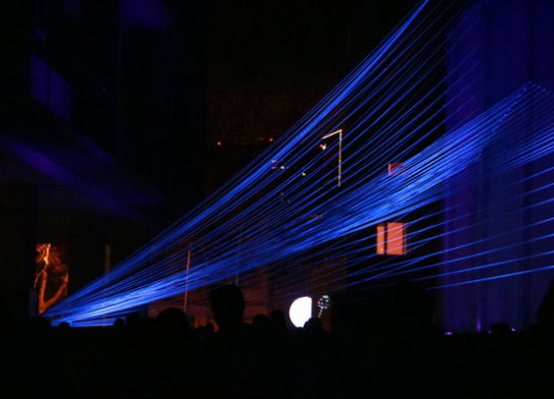 An art installation using string and blacklight in Barcelona on February 17 2019 (by Aina Martí)