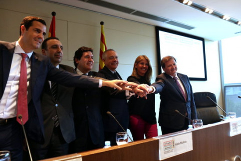 Senior Barcelona trade delegates celebrate the series of events