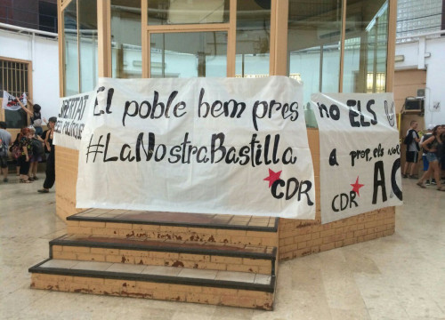 "A CDR banner in La Model prison reading ""the people has taken our Bastille"" (@CDRCatOficial)"