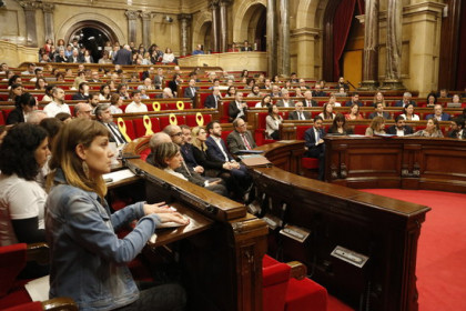 The Catalan parliament chamber with empty seats for the jailed and exiled leaders