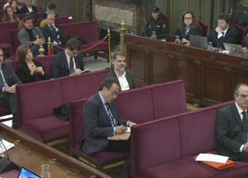 Jordi Cuixart is among the defendents listening in the dock