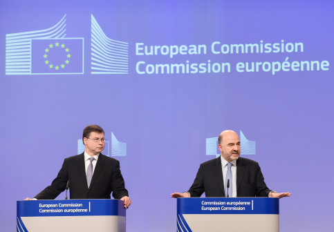Vice President Valdis Dombrovskis, responsible for the Euro and Social Dialogue Commissioner for Economic and Financial Affairs, Taxation and Customs, Pierre Moscovici (by EC)