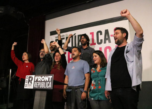Candidates raise their fists in solidarity at main Front Republicà campaign event