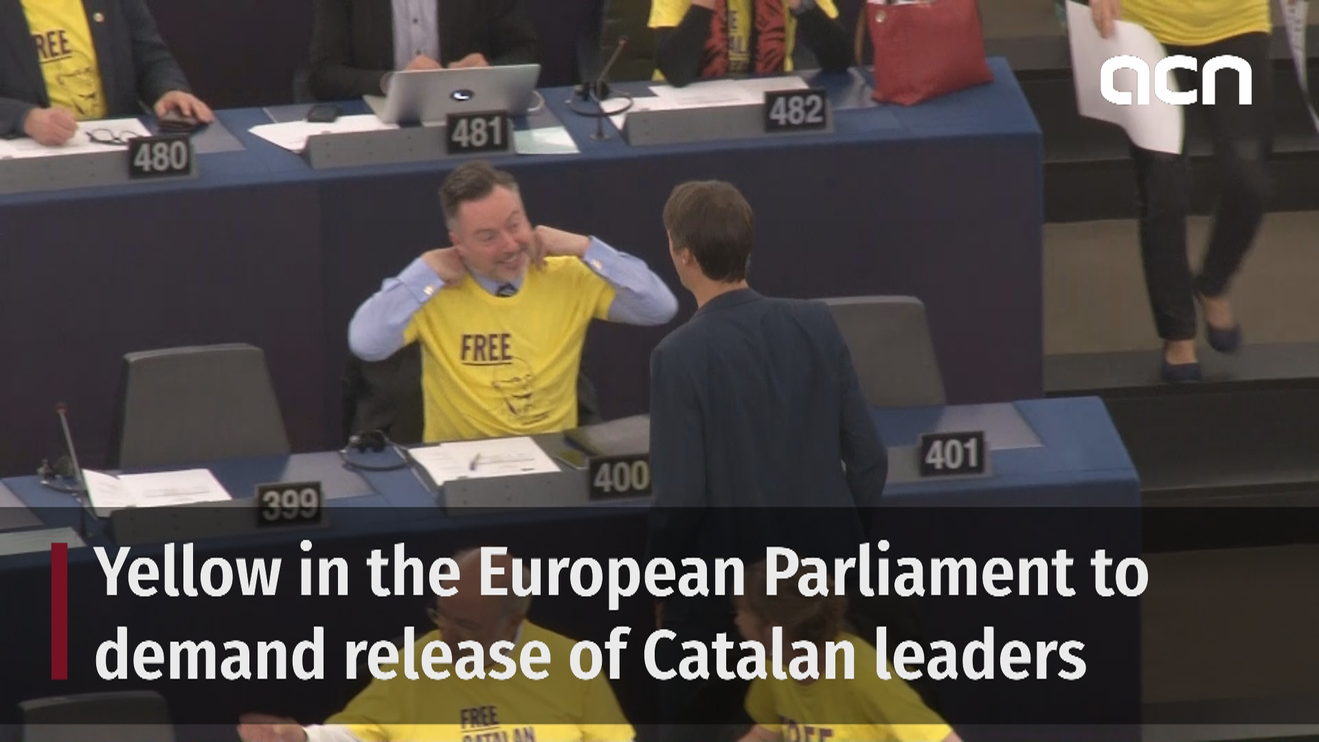 MEPs wear yellow to demand release of Catalan leaders from jail