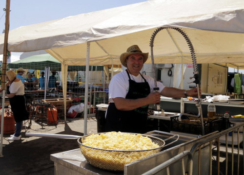 One of the snail chefs preparing salty snacks at the festival