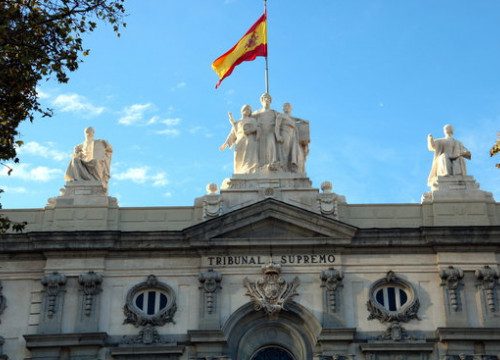 The Spanish flag flies above the Supreme Court in central Madrid