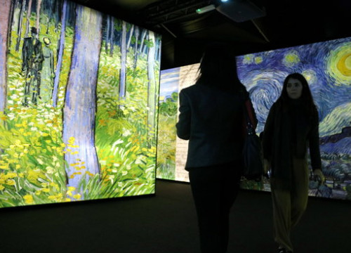 Two girls walk through installations for the new Van Gogh exhibit in Barcelona on March 14 2019 (by Pau Cortina)