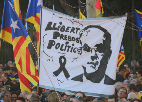 "A sign displaying jailed leader Jordi Turull reads ""freedom political prisoners"" surrounded by Catalan independence flags on February 16 2019 (by ACN)"