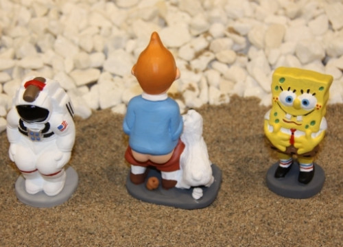 Caganers replicas of an astronaut, Tintin, and Sponge Bob (by X. Pi)