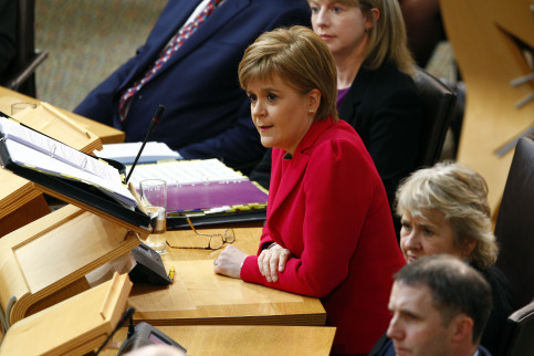 Nicola Sturgeon, First Minister of Scotland, speaking at the Scottish Parliament (by the Scottish Parliament)