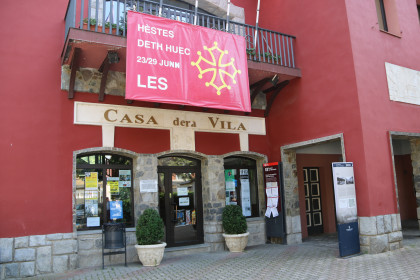 The town hall of Les, in the Val d'Aran, with a poster announcing the dates for a local celebration (by Marta Lluvich)