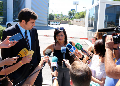 Pilar Abel and her lawyer talking to the press