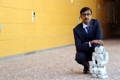 Researcher Jainendra Shukla with the robot aiming to improve treatment for autistic children and dementia sufferers (by Rovira i Virgili University)