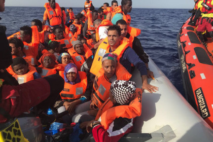 Proactiva Open Arms crew with rescued migrants (Proactiva Open Arms)