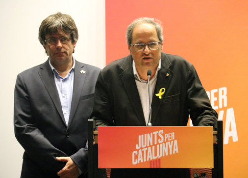The Catalan president, Quim Torra (right), with his predecessor, Carles Puigdemont in Brussels on August 27, 2018 (by Natàlia Segura)