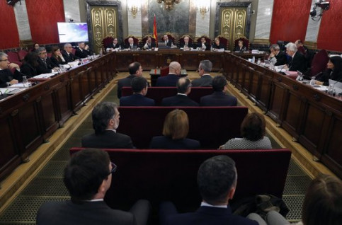 The jailed Catalan leaders in the dock surrounded by judges and lawyers in the courtroom on the first day of trial February 12 (photo courtesy of Pool EFE)