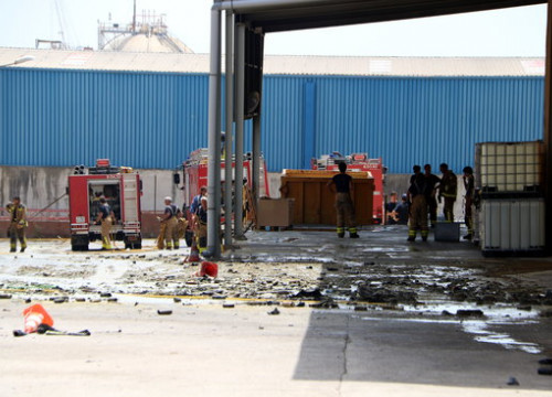 Aerosol cans and cleaning products scattered around the outside of the warehouse affected by the fire. (Photo: Mar Rovira)