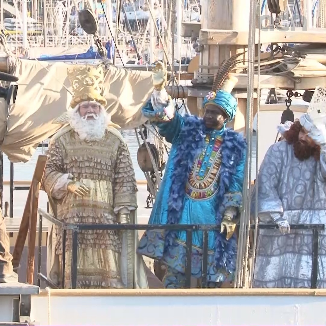 Three Wise Men greeted by throngs of children in time for Epiphany