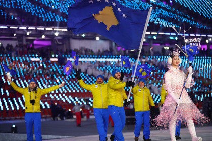 Kosovar athletes carry the national flag during the opening ceremony of the 2018 Winter Olympics (by Reuters)